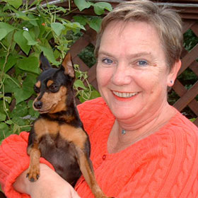 Gudrun Cobb, owner of Uncommon Paws poses with her favorite canine companion Baxter.